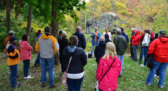 Beth Regan from the Mohegan Tribal Council of Elders and NHS President Bill Champagne give a guided Uncas Leap Tour