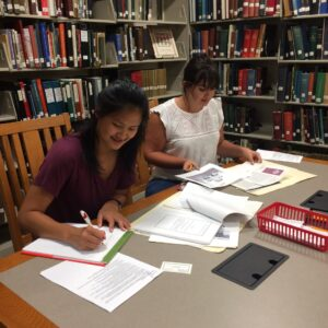 Haley and Madelyn working on a research project.